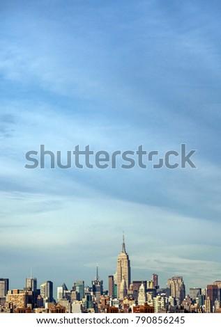 Skyline of Midtown Manhattan on an autumn afternoon. #790856245
