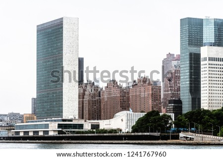 Skyline of Midtown of NYC from East River in Roosvelt Island a misty day #1241767960