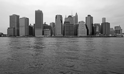 skyline of New York city with reflection on the water