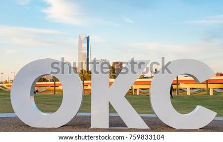 Skyline of Oklahoma City, OK with OKC sign