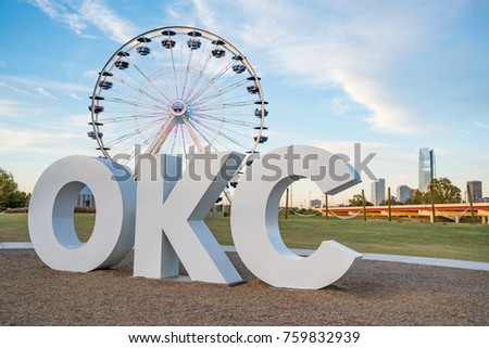 Skyline of Oklahoma City, OK with OKC sign and ferris wheel #759832939