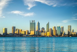 skyline of perth at dusk by swan river in western  australia