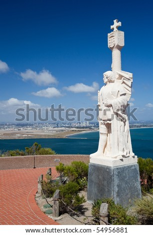Skyline of San Diego in background behind statue of Cabrillo on Point Loma
