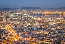Skyline of San Francisco Bay at night from panorama view point lookout of Twin Peaks - Urban travel concept with american world famous city on the atlantic coast - warm night color tones
