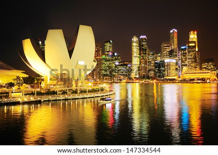 Skyline of Singapore at night. View from Helix bridge
