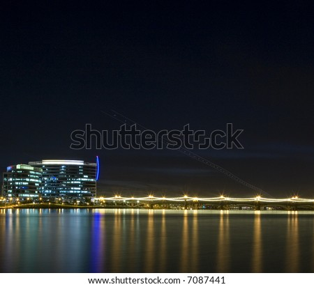 Skyline of Tempe Arizona photographed at night with reflections in lake
