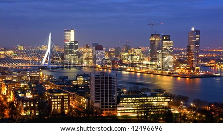 skyline of the city of rotterdam by night