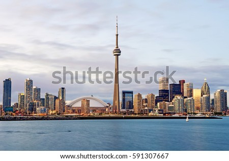 Skyline of the city of Toronto with shoreline of Lake Ontario at dusk