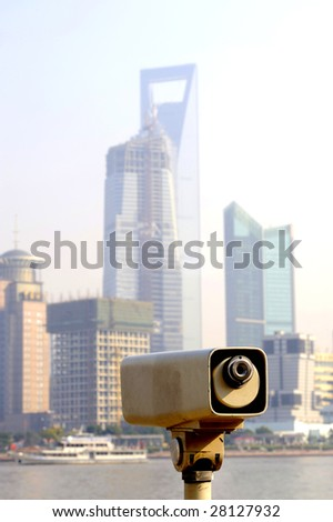 Skyline of the financial district of Shanghai with offices and hotels.At foreground a binocular