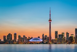 Skyline of Toronto over Ontario Lake at twilight