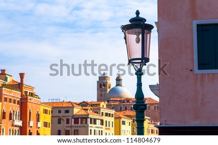 Skyline of Venice out of focus behind a lamppost.