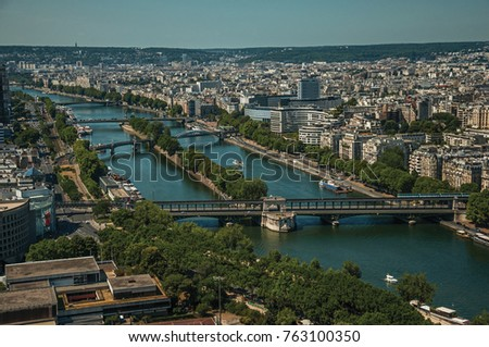 "Skyline, River Seine bridges and buildings under blue sky, seen from the Eiffel Tower in Paris. Known as the ""City of Light"", is one of the most impressive world's cultural center. Northern France. #763100350"