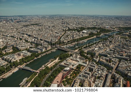 "Skyline, Seine River and buildings with sunny blue sky, seen from the Eiffel Tower top in Paris. Known as the ""City of Light"", is one of the most impressive world's cultural center. Northern France. #1021798804"