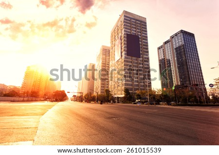 skyline,urban road and office buildings at sunset