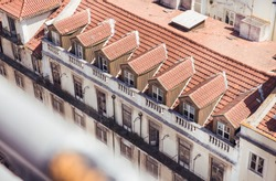 Skyline view of classic building with windows and orange roof in the city of Lisbon, Portugal