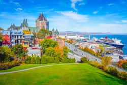 Skyline view of Old Quebec City with iconic Chateau Frontenac and Dufferin Terrace against St. Lawrence river in autumn sunny day, a national historic site of Canada, most famous landmark of Quebec.