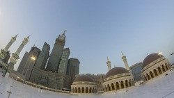 Skyline with  Abraj Al Bait (Royal Clock Tower Makkah) (left) in Makkah, Saudi Arabia. The tower is the tallest clock tower in the world at 601m (1972 feet), built at a cost of USD1.5 billion.