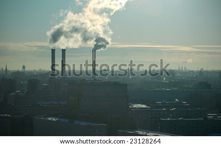 skyline with power station in backlight - stock photo