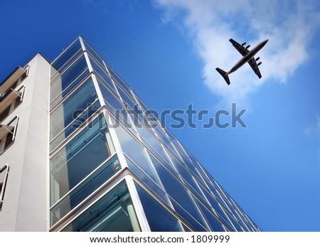 skyscraper and a airplane - stock photo