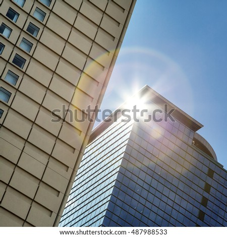 Skyscraper detail with natural lens flare.  #487988533