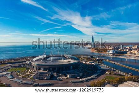 Skyscraper Gulf Finland. Autumn Park area. Residential complex. Stadium Zenit Arena. Top view air drone