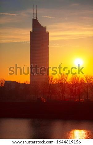 skyscraper in the twilight , view of sun dial