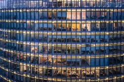 skyscraper Office windows and office worker by night square pattern