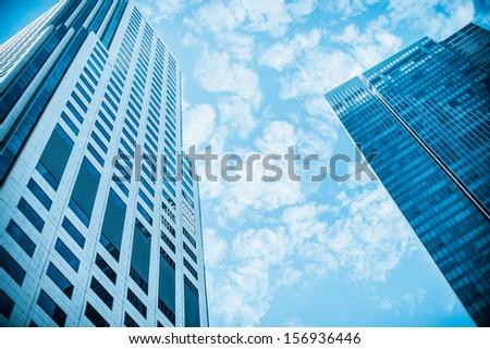 Skyscraper on the sky. Blue filter