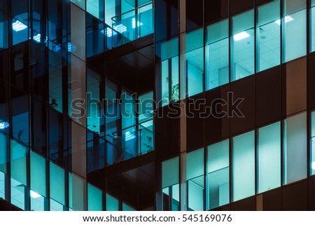 Skyscraper windows glow at night. Modern office building at night #545169076