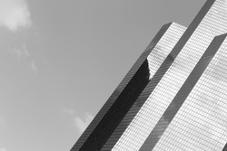 Skyscraper with glass facade. Modern building in Paris. Concepts of economics, financial, business  future. Copy space for text. Black and white.