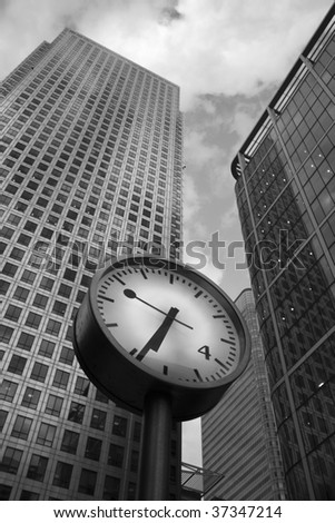 Skyscrapers and a clock at Canary Wharf, London, UK