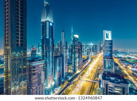 Skyscrapers and highways in downtown Dubai, UAE.  Nighttime skyline of a big modern city. #1324960847