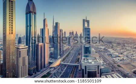 Skyscrapers and highways of downtown Dubai, United Arab Emirates, at sunset. Colourful skyline.