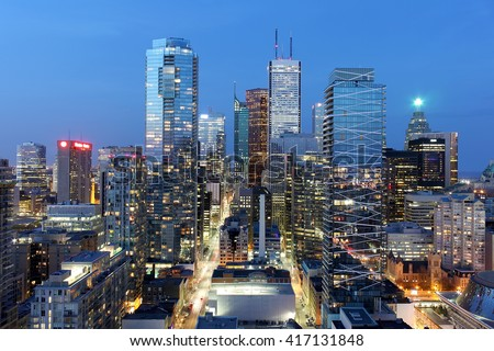 Skyscrapers and office buildings in downtown Toronto financial district at dusk