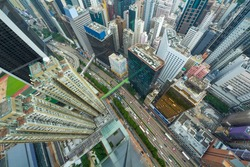 Skyscrapers, buildings, road in Hong Kong city, China at sunny day, top view from China Resources Building