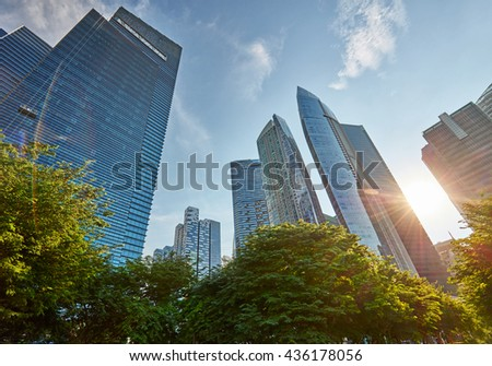 Skyscrapers in central business district of Singapore. Lens flare effect #436178056