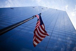 Skyscrapers in New York City with American flag