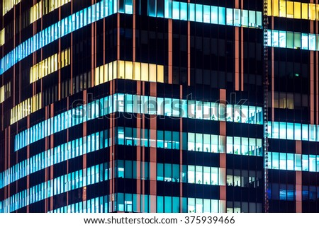 Skyscrapers Modern Office Building With Glowing Windows At Night