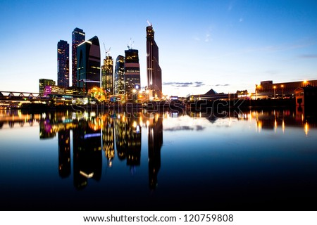 Skyscrapers Moscow business centre (Moscow City) at evening with water reflections.