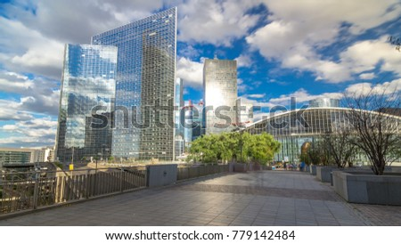 Skyscrapers of Defense modern business and financial district in Paris with highrise buildings and convention center. View from bridge. Blue cloudy sky in summer day. Reflections #779142484