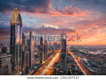 Skyscrapers of Dubai downtown with modern subway and highway infrastructure at beautiful sunset known as business district. #1361207513
