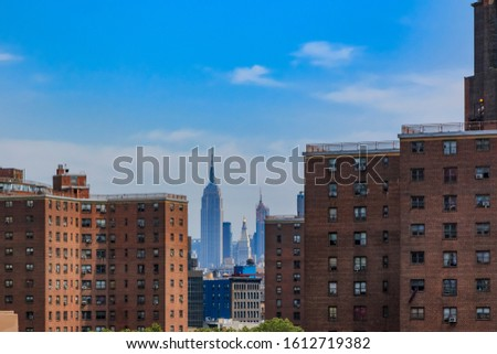 Skyscrapers of Midtown Manhattan, country's commercial, entertainment, media and financial center behind brick facades in Lower Manhattan New York Stock fotó ©