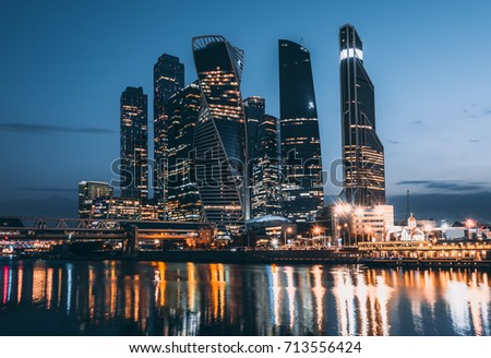 Skyscrapers of Moscow City business center and Moscow river in Moscow at night, Russia.  Architecture and landmark of Moscow #713556424