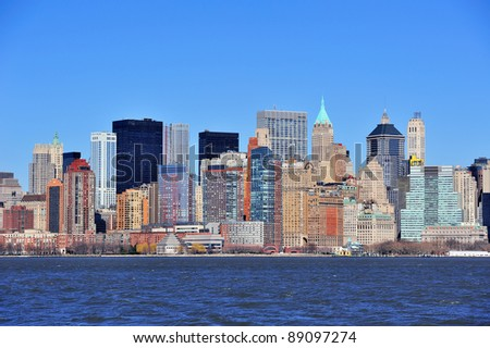 Skyscrapers of New York City Manhattan downtown with urban city skyline over Hudson River with blue clear sky
