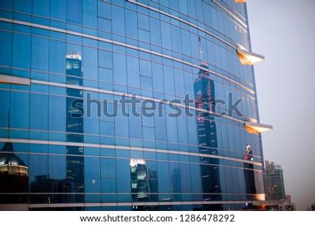 Skyscrapers reflected in the windows of another skyscraper. #1286478292