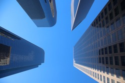 skyscrapers. tall buildings seen from the ground up towards the sky.