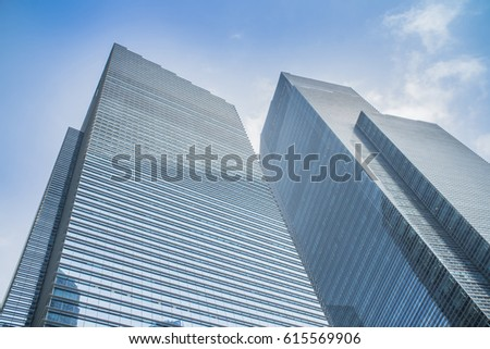 Skyscrapers with glass facade. Modern buildings in business district. Concepts of economics, financial, future