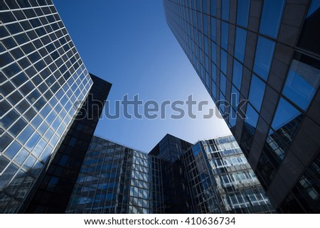 Skyscrapers with glass facade. Modern buildings in Paris business district. Concepts of economics, financial, future.  Copy space for text. Dynamic composition #410636734