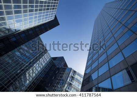 Skyscrapers with glass facade. Modern buildings in Paris business district. Concepts of economics, financial, future.  Copy space for text. Dynamic composition #411787564
