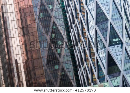 Skyscrapers with glass facade. Modern buildings in Paris business district. Concepts of economics, financial, future.  Copy space for text. Dynamic composition #412578193